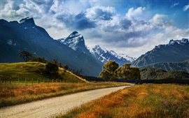 Preview wallpaper New Zealand nature landscape, mountains, road, trees, grass, clouds