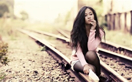 Preview wallpaper Asian girl on the tracks