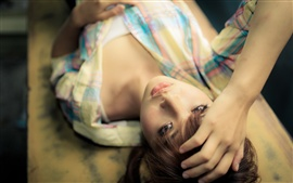 Preview wallpaper Beautiful Asia girl lying down