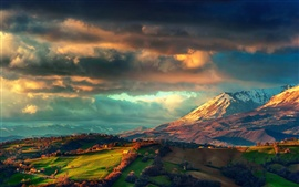 Italy, the Apennines, spring scenery, sunrise, clouds, fields, mountains