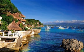 Preview wallpaper Resort area, coast, sea, huts, sailboats, blue water and sky