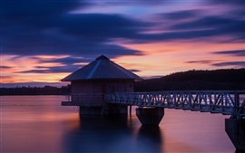 Preview wallpaper Sunset scenery, lake, house, bridge, purple sky