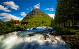 Valldal in Norway, waterfall, mountain cabins, trees