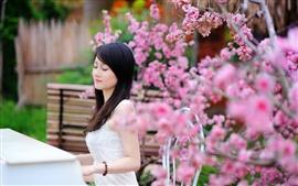 Asian girl, play piano, garden flowers