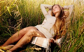 Preview wallpaper Girl relaxing in grass