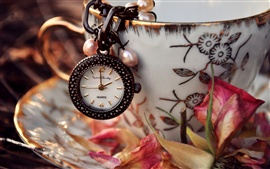 Preview wallpaper Watch, pendant, cup, saucer, dry flower petals