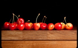 Delicious red cherry, wooden table