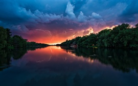 Preview wallpaper Dusk scenery, river, storm clouds, house, trees, lightning