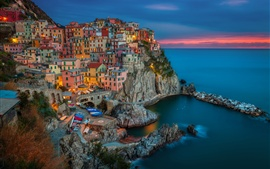 Preview wallpaper Manarola, Italy, evening sunset, houses, buildings, coast, rocks