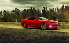 Preview wallpaper Chevrolet Camaro red muscle car, trees, clouds