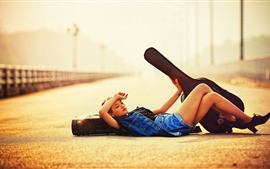 Preview wallpaper Guitar girl lying on road, sunlight