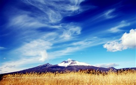 Mountains, fields, blue sky, white clouds