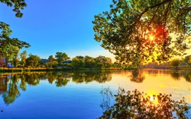 Preview wallpaper Spring sunset, lake water reflection, trees, sunlight, blue sky