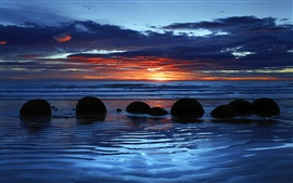 Preview wallpaper Moeraki Boulders, Koekohe Beach, Otago, New Zealand, sunset, clouds