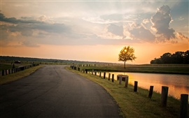 Preview wallpaper Nature landscape, sunset, tree, road, river, fence, sky clouds