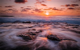 Preview wallpaper Sea, beach, waves, reefs, sun, dawn, red sky
