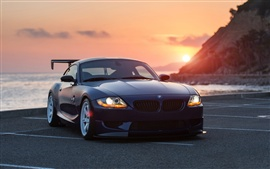BMW Z4 carro preto ao pôr do sol