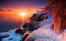 Beautiful winter sunrise, lake, ice, snow