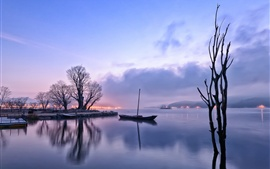 Preview wallpaper Early morning, dawn, lights, lake, reflection, boat, trees, fog