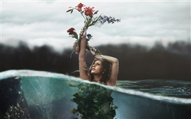 Girl hold up flowers in the water, creative pictures
