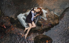 Preview wallpaper Girl lying river side stones