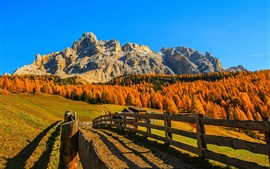 Preview wallpaper Autumn landscape, red trees, mountains, sky, clouds, houses, fence