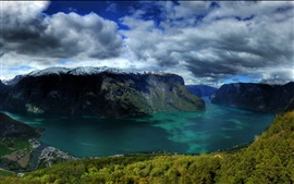 Preview wallpaper Norway, river, rock mountains, snow, clouds, small town