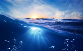 Preview wallpaper Ocean, sunset, sun, blue water, bubbles