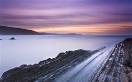 Spain beach rocks, bay, sunset
