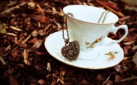 Preview wallpaper Cup, saucer, heart pendant, chain, pendant, autumn