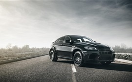 Preview wallpaper BMW X6M black car in the road