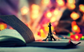Eiffel Tower model, book, colorful lights