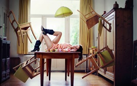 Girl in the room, chairs flying, creative