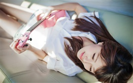Preview wallpaper Girl lying bed, guitar, music