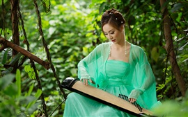 Preview wallpaper Asian girl playing the zither