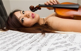 Preview wallpaper Asian girl, violin, music, bed