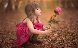Preview wallpaper Cute little girl holding rose flower