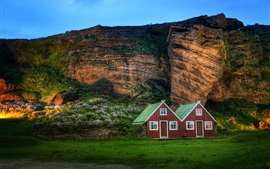 Preview wallpaper Iceland scenery, mountain, rock, hut, sunlight, dusk