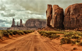 Monument Valley, Arizona, USA, road, gravel, rocks, bushes, clouds