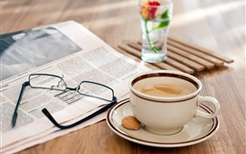 Still life, wooden table, glasses, newspaper, coffee