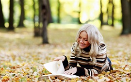 Autumn forest, girl read a book