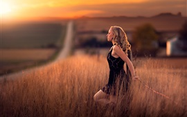 Preview wallpaper Girl in the fields, road, calm, dusk