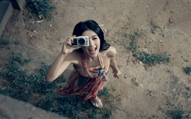 Preview wallpaper Happy girl use the camera