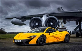 Preview wallpaper McLaren P1 Yellow supercar at airfield