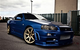 Nissan Skyline GTR R34 vista lateral do carro azul
