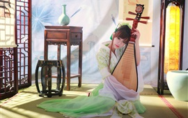 Beautiful classical Chinese girl playing the pipa