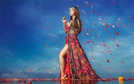 Beautiful girl in water, gait, petals, flowers