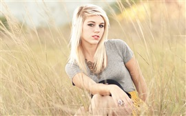 Preview wallpaper Blonde girl in the summer grass
