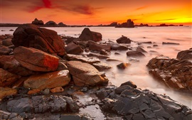 Coast, sea, stones, sunset, red sky