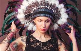 Girl face, tattoos, hat, feathers